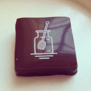 Hidden beneath the fourteenth course at Eleven Madison Park, revealed via a card trick -- a honey-flavored chocolate.