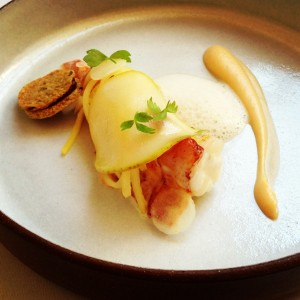 Eighth course at Eleven Madison Park: Lobster (Poached with Rutabaga, Black Pear, and Lovage)